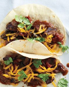 A slow cooker turns an inexpensive cut of meat into a crowd-pleasing Carne Guisada; great served in warm flour tortillas