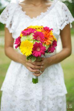 A Truly Fun & Bright Bridal Bouquet Showcasing: Sunny Yellow Gerbera Daisies, Orange Gerbera Daisies, Hot Pink Gerberas, Green Hydrangea, & Bush Ivy*****************************