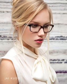 A blonde bombshell wearing glasses!