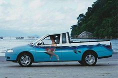 Fun photo and vehicle paint job!look like you're always on your surfboard, waiting to catch a wave, no matter where you' re really headed!) Hahaha, that's epic! Luxury Sports Cars, Sport Cars, Dodge Durango, Volkswagen, Beach Cars, Van Wrap, Surfer Magazine, Transporter, Akita
