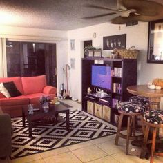 My college apartment! IKEA rug, coffee table and entertainment center. Thrift shop couches. Beatles poster. Bar table from my parents. Flowers from my boyfriend.