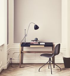 A nice little corner work space accessoried with a really good looking lamp from Best & LLoyd
