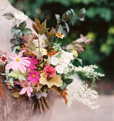 WILDFLOWERS - The easiest way to get what's truly in season? Go foraging for your own flowers for a rustic bouquet of colorful wildflowers with autumn leaves and branches. The best part? It's free and a fun activity for you and your bridesmaids.