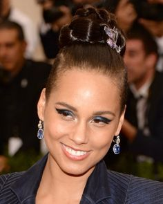 Pin for Later: Zoom In on Every Gorgeous Hair Accessory From the Met Gala Alicia Keys Alicia added a purple floral pin to her mohawk hairstyle.