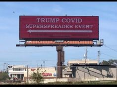 This billboard outside the Des Moines Airport in Iowa points toward one of President Donald Trump's campaign rallies, which was scheduled to be held on October 14, 2020. The sign draws attention to the danger of holding such large rallies during this pandemic.