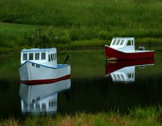 Picture of mini-boats in a garden pond aiming for a beach theme.