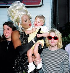 RuPaul trying to calm Kurt Cobain's daughter, Frances Bean Cobain, backstage at the 1993 MTV Video Music Awards. | 26 Incredible Pictures Of Famous People Throughout History