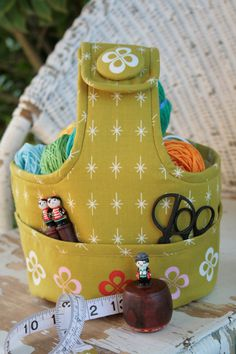 Bruce is the perfect little crafty carrier. He has pockets front and back and enough room for a small project or two. He carries everything and you will never hear a word of complaint. Everyone needs a Bruce in their lives!  Bruce is approx 23 inches around and 10 inches high The boring bits: You may sell items made from this pattern provided: • The item is made by you and you alone. • Items cannot be mass produced. • You give credit to the designer Jodie Carleton on either the swing tag…