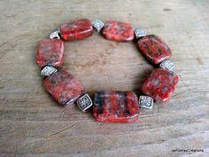 Red Jasper Stretch Bracelet with Pewter Celtic Knot Metal Beads by JamieRayCreations https://www.etsy.com/listing/177745858/red-jasper-bracelet-with-pewter-celtic?