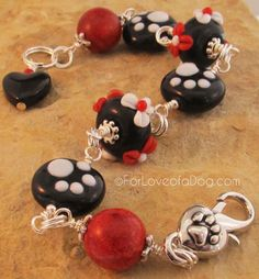 This handmade bracelet is sooooo pretty!!    Paw Print Bracelet Red Coral Lampwork Black Heart