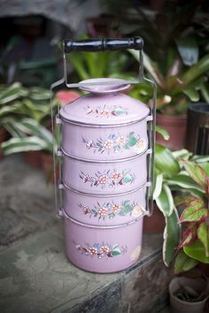 Peranakan stacking bowls/tiffins. Fell in love with this style in Singapore. Very beautiful option for serving food.