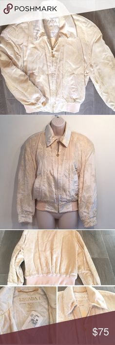 """NWT vintage Escada snowflake velour bomber jacket Awesome Escada vintage jacket! Goldtone hardware. 2 front pockets, lightly padded shoulders. Off white w/ snowflake print throughout. 100% cotton. Feels a bit like velour. Fully lined (lining feels like silk!) Labeled size 36- fits an extra small. Measures 23"""" long, 21"""" flat across chest, 30"""" stretch bottom opening, & 20"""" sleeves. Fantastic vintage condition- only """"flaws"""" are very tiny/not even holes on bottom, see last pic- not noticeable…"""