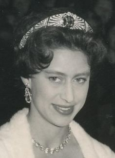A close up of Margaret, with the sapphire tiara, on her way to the Germany Embassy with her mother, Queen Mary, in 1958