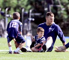 New England Patriots quarterback Tom Brady relaxes with his sons Jack and Benjamin after he finished up his training camp at Gillette Stadium.