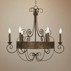 "I like the airiness of this one.  More than I want to spend but I will keep my eye on it.  $400   Rust Candelabra 30"" Wide Bronze Scroll Chandelier -"