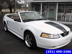 Check out this 1999 Ford Mustang GT in Crystal White from Downey Wallace Auto Sales. It has an Automatic. Engine is 4.6L SOHC SMPI V8 ENGINE. Call Today!
