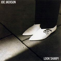 Joe Jackson - Look Sharp! - My favorite album ever made at one time! This hit machine is first album from Joe Jackson. A MUST OWN rock album! Iconic Album Covers, Greatest Album Covers, Classic Album Covers, Cool Album Covers, Music Album Covers, Music Albums, Music Music, Sheet Music, Lp Cover