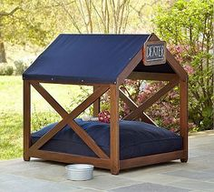 Chatham Dog House from Pottery Barn. Simple but really cute. Would love this next to a pool!