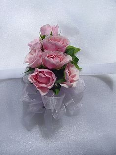 Simple pink spray rose corsage