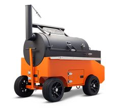 Yoder Smokers Cimarron Pellet Cooker mounted on a competition cart, with steel prep shelves and casters. Unparalleled mobility with superior heat control for competition pitmasters.  #WhyIYoder #BBQ