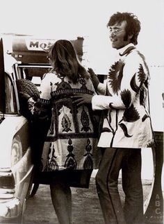 Cynthia and John Lennon at Heathrow Airport, arriving back from their trip to Greece.