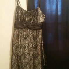 black dress with white/ivory underneath In excellent condition.  Wore once. Doesn't fit anymore.  Has zipper in back. Black satin sash.  Black satin ribbon like straps. Great for a date or wonderful evening. Has white underneath the black. Ruby Rox Dresses