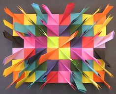 Relief Sculpture --- fold into a half rectangle, flip the corners to create a square..... glue in a pattern