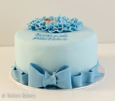 Blue fondant cake with bow and fondant baby #tekilasbakery