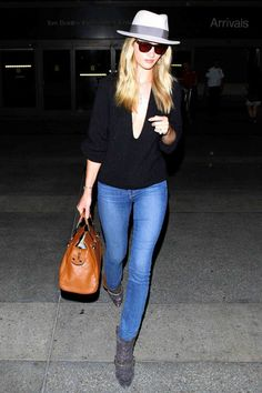 Rosie Huntington-Whiteley gives her casual AG skinnies and Isabel Marant boots a polished update with a pale gray chapeau by Maison Michel.