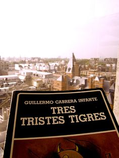 A masterpiece of XX century, Tres Tristes Tigres (Three Trapped Tigers) by the Premio Cervantes winner Guillermo Cabrera Infante. Censored in Spain under Franco & read clandestinely in the author's homeland, Cuba. 1st published in 1967, the book was only available in its original entirety in Spanish in 1989 - in Venezuelan Biblioteca Ayacucho edition. Photo shows 1 original copy of the uncensored 1989 edition. Background view of South Kensington, where author lived from 1967 til death in…