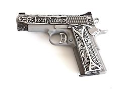 Kimber CDP II 1911 - customized by Jesse James =) perfect for my purse!
