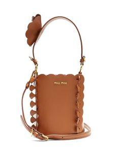 Flower-embellished leather bucket bag | Miu Miu | MATCHESFASHION.COM US