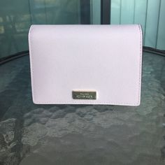 Kate Spade Cara Wallet -Color: pale/blush pink.  -Condition: good, used three times ---It does have a small mark on the front and some small ones on the back.   ❌No trades!❌ Smoke free.  Best offer. kate spade Bags Wallets