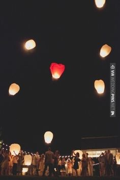 floating skylanterns at the end of the wedding reception // photo by | VIA #WEDDINGPINS.NET