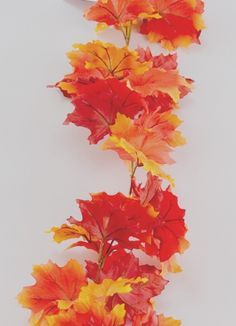 "Brighten up your home decor and fall wedding with the brightly colored Autumn Maple Leaf Garland.   Autumn Maple Leaf Garland is a silk garland that measures 66"" Long with 3"" leaves."
