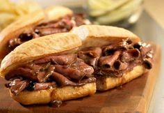 """Hot Roast Beef Sandwiches -  1 can (10 1/2 oz) Brown Gravy w/Onions,  12 oz sliced deli roast beef,  4 long hard rolls, split :  Heat gravy in 10"""" pan to a boil. Add beef to pan. Reduce heat to low. Cook until mix is hot & bubbling."""