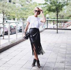 Plain white tee on statement skirt