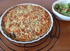 Hartige taart met tomaten, champignons & kaas
