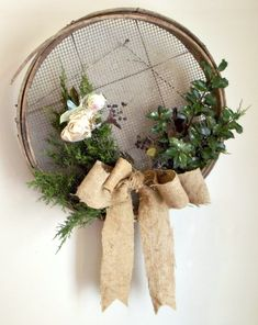 Garden fairy themed Christmas wreath using found greenery from outdoors with a burlap bow