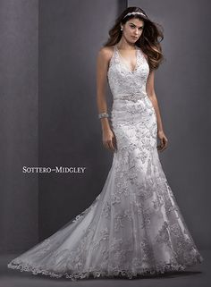 Dreamy lace sheath wedding dress, complete with plunging halter neckline and keyhole back, Lorella by Sottero and Midgley.