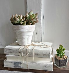 Chalk Paint® decorative paint by Annie Sloan in Old White drybrushed over a terracotta pot and old books to create a stylish design vignette at home | Blue Sage Designs