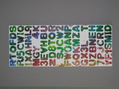 Letters added to a canvas, gesso over the top, then rolled on paint.