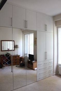 This carpentry company has photos of the kind of mirrored doors/white mixture that I'd like our fitted wardrobes to have. Get some recommendations and have them around for a consult when ready to have the closets done!