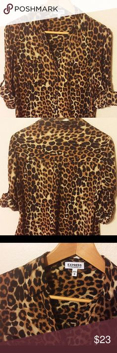 Express Convertible Sleeve Portofino Shirt Express Convertible Sleeve Portofino Shirt. Brown/Black leopard print, long-sleeve, button-up shirt. Sleeves can be worn long or rolled up, as shown. Fits true to size. 100% Polyester. Excellent condition, no flaws. Express Tops Blouses