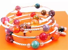 """This """"Gorgeous Fire Mixed Agate"""" Wrap Bracelet is strung on stainless steel memory wire and it wraps around your wrist five times in Fire Mixed Agate Semi-precious beads with handmade dangling charms in various sized crystal Beads.(Bead size range 3-6mm) and Sterling Silver .925 long thin, short and twisted tubes, sizes arranging from (1.5x10mm). The memory wire allows a nice comfortable fit, so these bracelets can be worn on arms of different sizes in adults. PLEASE NOTE: We photographed…"""