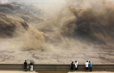 Crowds gather in China's Henan province to watch water gush from the Xiaolangdi dam to clear up the Yellow river and prevent localised flooding.