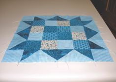 "A traditional pattern called ""Checkerboard Star."" Pieced by Pam Wilson in June 2014, incorporating gingham and other fabrics from the stash of my aunt Johanna Wackerle Tanner."