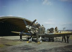 A Supermarine Spitfire Mark IX of No 64 Squadron, Royal Air Force undergoing an engine overhaul just outside a blister hangar on the north side of Fairlop airfield in Essex. The aircraft had been pushed outside the hangar for the photograph. Ww2 Aircraft, Fighter Aircraft, Fighter Jets, Pilot, The Spitfires, Air Festival, History Online, Supermarine Spitfire, Ww2 Planes