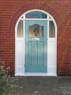 Traditional wooden Grand 30's front door with 'Colourfilm Leaded' glazing and arched frame - Didsbury 2014