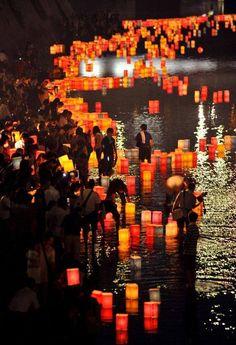 Paper lanterns floating on the Motoyasu River at the Peace Memorial Park in Hiroshima, Japan.
